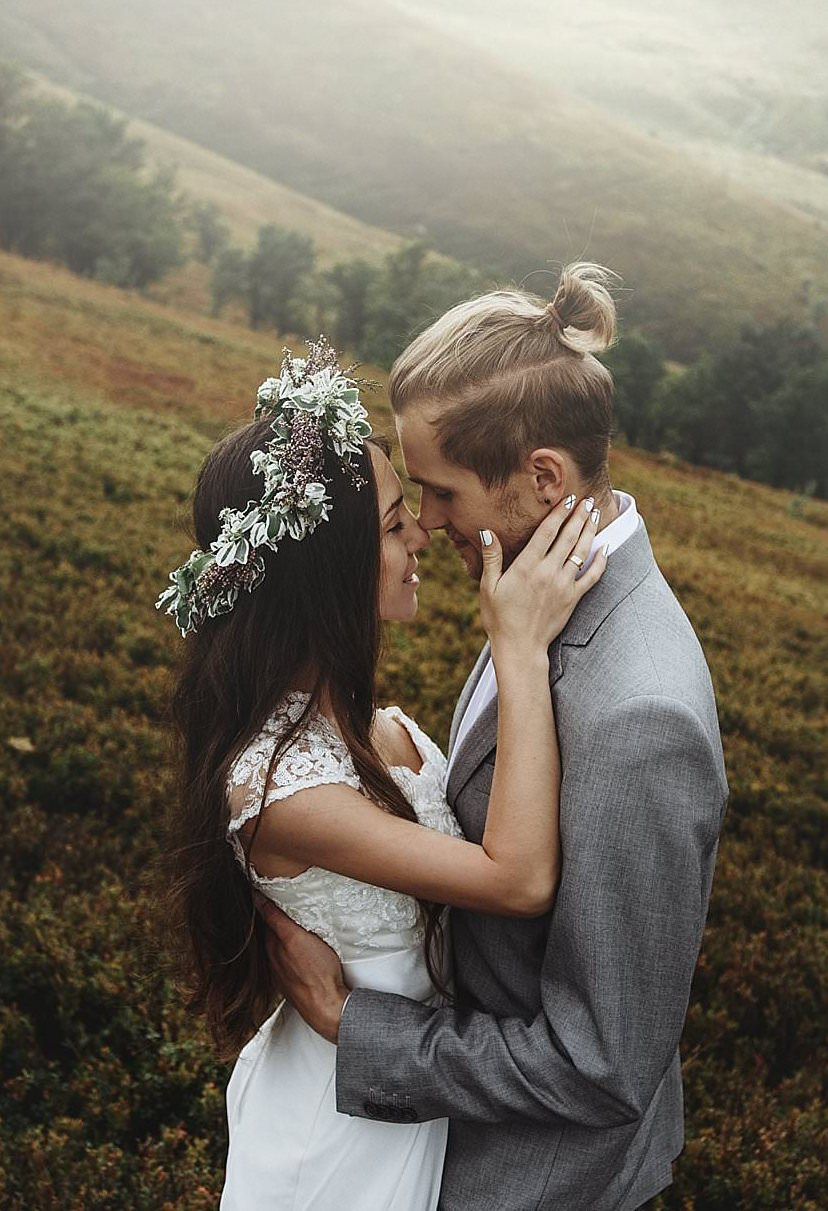 beautiful fabulous happy  bride and stylish groom on the background of  the sunny  stunning mountains